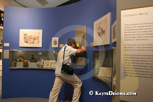 A visitor looks through one of the interactive exhibits at the Jewish Museum Berlin, Germany.