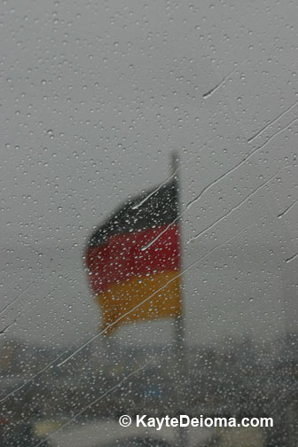 The German flag seen through the rain-spattered Reichstag Dome.