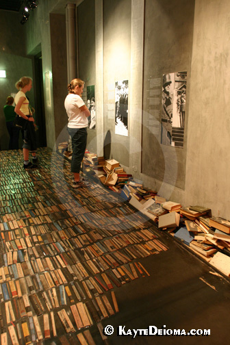 A corridor paved with books represents the books burned under the Third Reich at the Story of Berlin.