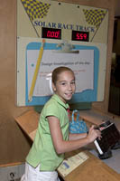 A young girl builds a scale model of a solar car at the Museum of Science, Boston, MA
