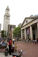 A musician plays in front of Quincy Market, Faneuil Hall Marketplace, Boston, MA