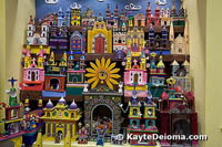 A colorful exhibit of churches at the Casa de Arte Popular in Cancun, Mexico.