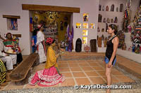 A visitor admires the life-size figures in the chapel created at the Mexican Folk Art Museum.