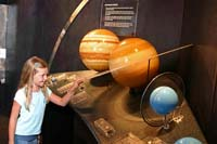 Becca examines the rings of Saturn