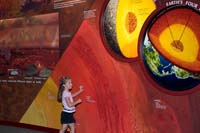 Sarah explores the textured wall of the Molten Earth Exhibit at the Cleveland Museum of Natural History