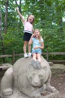 Sarah and Becca pose on top of &quot;Old Grizzly&quot; in the Wildlife Center and Woods Garden at the Cleveland Museum of Natural History.
