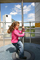 Sarah learns about momentum at the Great Lakes Science Center in Cleveland.