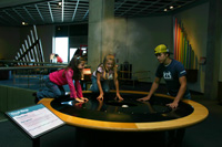Teamwork: Derick, Becca and Sarah create cloud formations at the GReat Lakes Science Center in Cleveland.