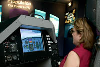 Carol tries out the flight simulator at the NASA Glenn Research Center.