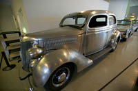 This 1936 Ford Deluxe is part of a set of three stainless steel Fords at the Crawford Auto-Aviation Museum.