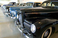A row of classic cars at the Crawford Auto-Aviation Museum.