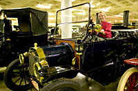 Museum Director Allan Unrein gives a lesson on how to drive a Model T at the Carawford Auto-Aviation Museum, Cleveland, Ohio.