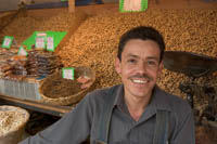 Vendor, Javier, sells peanuts and other nuts on the patio at Mercado Libertad, Guadalajara, Mexico.