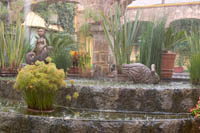 A sudden downpour splashes in the fountain at Quinta Real Hotel, Guadalajara, Jalisco, Mexico