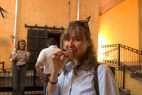 Cristina Martinez tastes a piece of roasted blue agave at Mundo Cuervo, Tequila, Mexico.