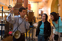 A guide holds up a bottle of undiluted tequila fresh from the still on the Jose Cuervo factory tour.