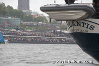 Spectators line the banks of the Elbe River to watch the opening procession of ships for the Hamburg Harbor birthday Celebration in the rain.