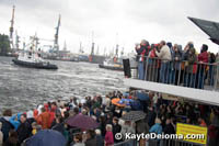 Crowds watch the Tugboat Ballet in the rain at the Hamburg Harbor Birthday.