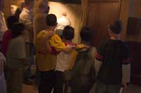 Boys cower in front of the intimidating entrance to the Ghosts and Legends special effects tour aboard the Queen Mary, Long Beach, CA.