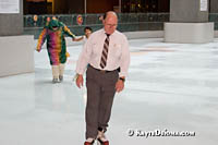 Bus driver Denis Boisvert glides around Atrium Le 1000 skating rink in Montreal on his lunch break. Š Kayte Deioma