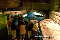 Visitors stand in the aqueduct that turned the Little St. Lawrence River into a sewer. Š Kayte Deioma