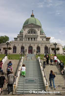 A pilgrim climbs the stairs of St. Joseph's Oratory on her knees. Montreal. Š Kayte Deioma