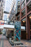 A piece of the Berlin Wall is on display in the atrium of the Montreal World Trade Center. Š Kayte Deioma