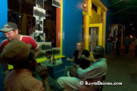 Patrons sit outside Cafe Brasil on Frenchmen Street in the Faubourg Marigny neighborhood of New Orleans, LA