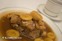 Banana bread pudding in praline sauce at Galatoire's in the French Quarter, New Orleans, LA.
