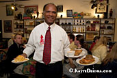 Native New Orleanian Harold Toussaint delivers award-winning fried chicken and roasted chicken at the Praline Connection Southern Creole Soulfood Restaurant on Frenchmen Street in New Orleans, LA