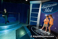 Sarah and Becca sing for a wax Simon on the American Idol set at Madame Tussauds