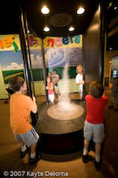 Kids generate a tornado at the Family Museum in Bettendorf.