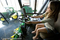 Driving a combine at the John Deere Pavilion