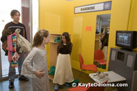 Two budding actresses get fitted for their wardrobe at the Zeum in San Francisco.