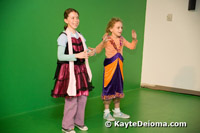 Two girls in funny costumes sing karaoke in the Music Production Lab upstairs at the Zeum.
