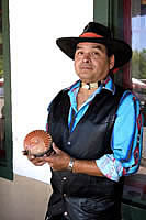 Pueblo artist Lorenzo Fuentes displays one of his pots for sale in front of the Palace of Governors as part of the Native American Artisans Program of the Museum of New Mexico.